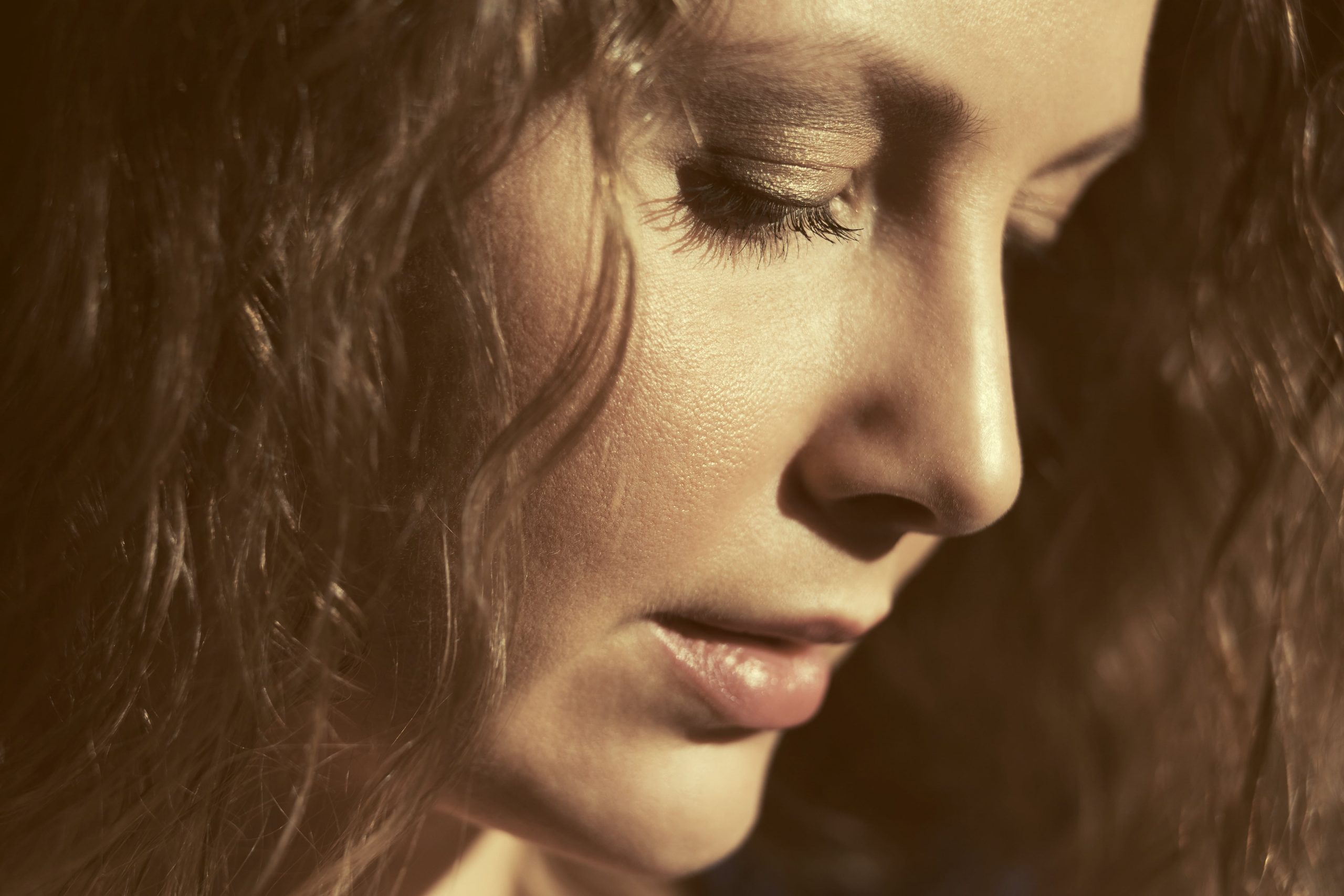 woman looking down in contemplation of meth use
