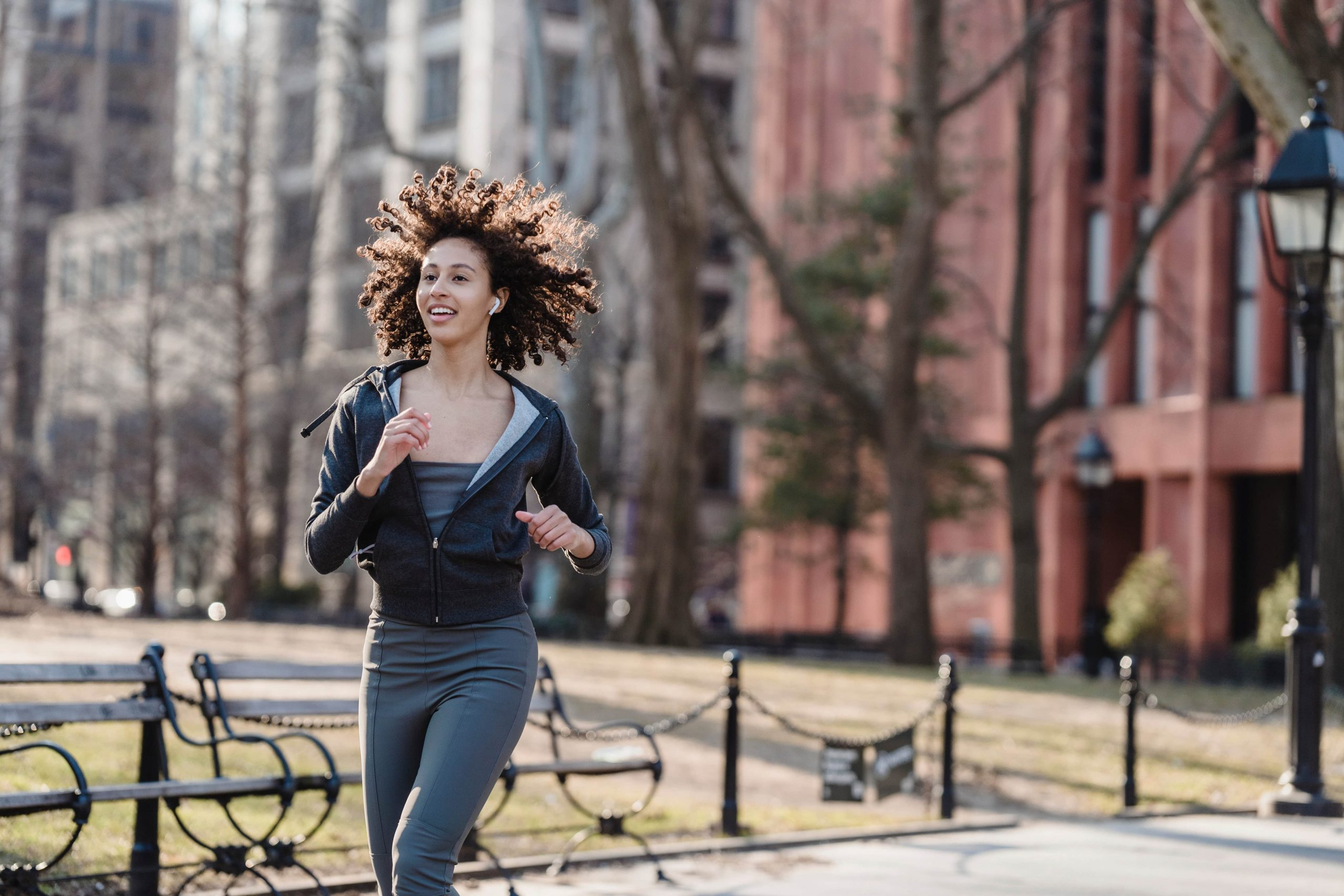 a woman running to signify keeping up a healthy body and immune system