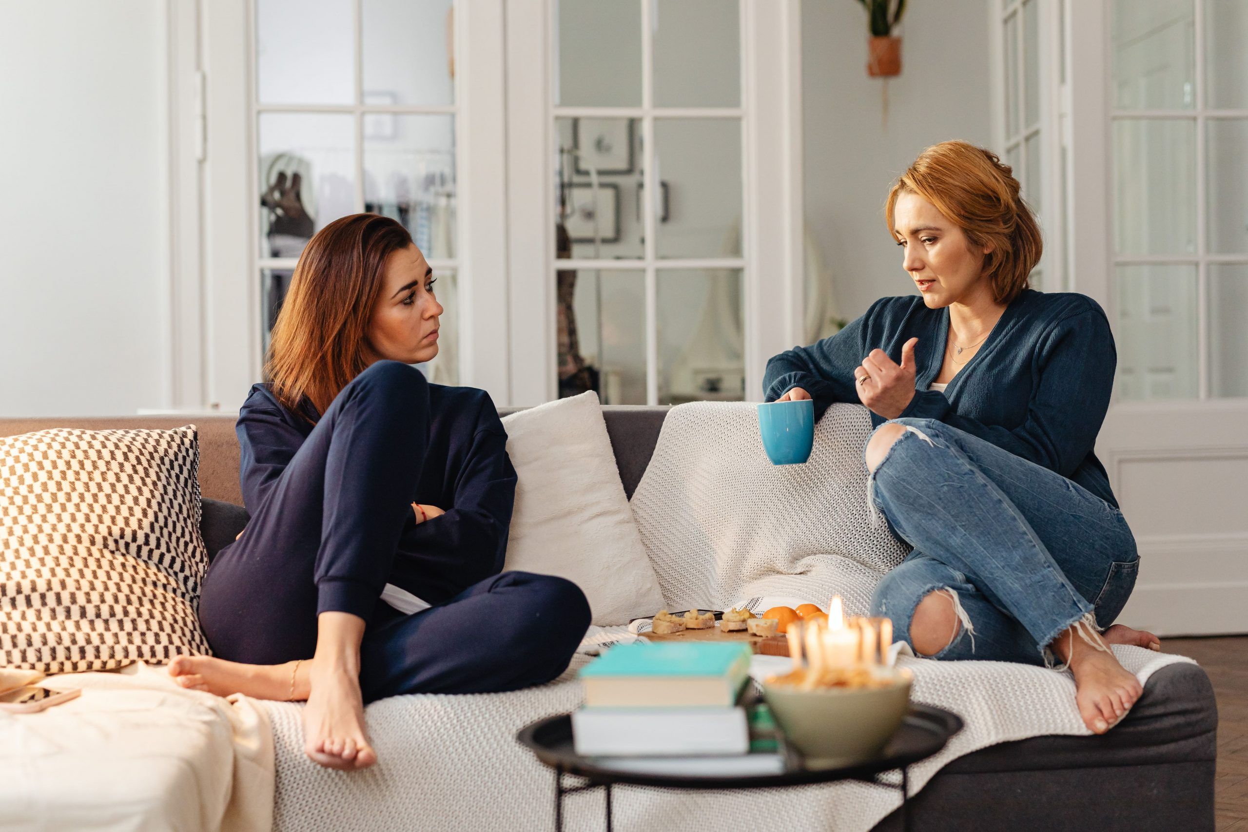 woman sitting with her friend who is experiencing addiction